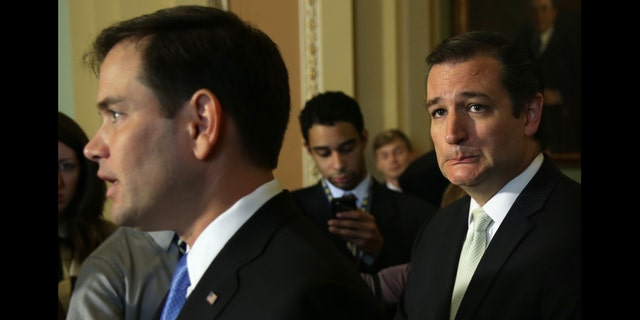 WASHINGTON, DC - SEPTEMBER 27: U.S. Senator Ted Cruz (R-TX) (R) and Senator Marco Rubio (R-FL) (L) speak to members of the media after a vote on the Senate floor September 27, 2013 on Capitol Hill in Washington, DC. The Senate has passed a continuing resolution 54-44 to fund the government through November 15 with the exclusion of defunding the Obama care in which the provision was passed in the House. (Photo by Alex Wong/Getty Images)