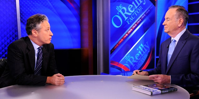 """Sept. 22, 2010:This file photo shows Comedy Central's Jon Stewart from """"The Daily Show with Jon Stewart"""" left, and and political pundit Bill O'Reilly during an interview for """"The O'Reilly Factor"""" on FOX News Channel, in New York."""