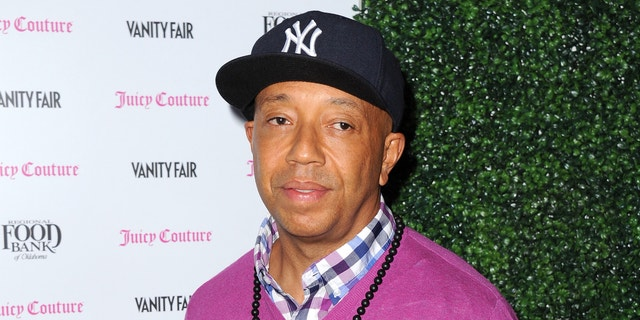 In this Feb. 18, 2013 file photo, Russell Simmons arrives at the Vanity Fair and Juicy Couture Celebration for the 2013 Vanities Calendar in Los Angeles. Simmons is apologizing for a parody video of Harriet Tubman in a sex tape that appeared on his All Def Digital YouTube channel.