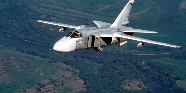 """FILE  In this file photo taken in this 2002 shows a Russian Su-24 medium-range bomber, known by NATO as """"Fencer,"""" flies somewhere at undisclosed location in Russia. A senior Russian government official said Friday March 27, 2015 that  Moscow hasn't held negotiations on leasing a dozen of supersonic bombers to Argentina, but would be willing to consider it.(AP Photo/File)"""