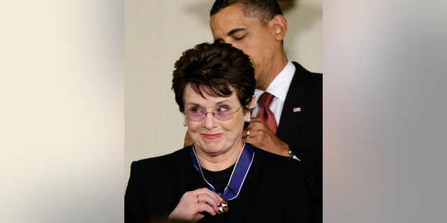 """In this file photo, President Barack Obama presents the 2009 Presidential Medal of Freedom to Billie Jean King, known for winning the famous """"Battle of the Sexes"""" tennis match, and championing gender equality issues, during ceremonies at the White House in Washington."""