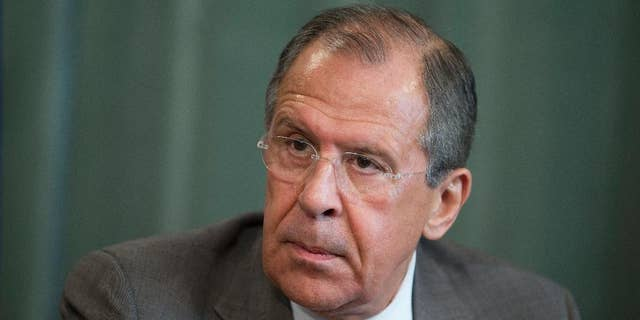 Russian Foreign Minister Sergey Lavrov attends a press conference after meeting with his South Sudanese counterpart Barnaba Benjamin at the Foreign Ministry mansion in Moscow, Russia, Monday, May 26, 2014. Sergey Lavrov said Russia has a positive view on Ukraine's presidential vote and is ready to deal with billionaire candy tycoon Petro Poroshenko, who holds a commanding lead, according to early returns. (AP Photo/Pavel Golovkin)