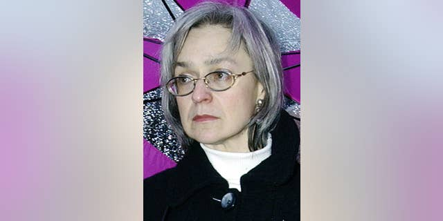 In this Oct. 2004 file photo reporter Anna Politkovskaya attends a rally against war in Chechnya in downtown Moscow, Russia.