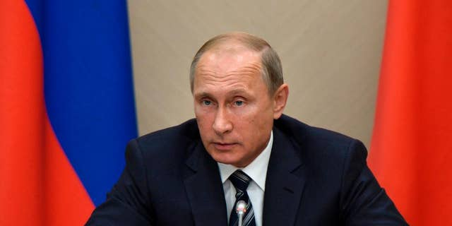 Sept. 30, 2015: Russian President Vladimir Putin holds a meeting with senior government officials at the Novo-Ogaryovo residence outside Moscow, Russia.