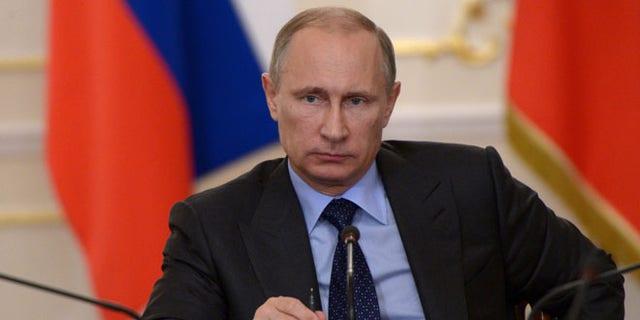 Russian President Vladimir Putin at the Novo-Ogaryovo residence outside Moscow on Thursday, July 10, 2014.