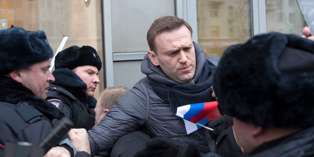 Russian police arrested Putin foe Alexei Navalny at a protest in Moscow Sunday.