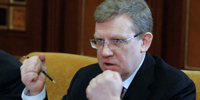 FILE 2011: Russian Finance Minister Alexei Kudrin gestures at a meeting on military salaries chaired by President Dmitry Medvedev in the Gorki residence outside Moscow, Russian.