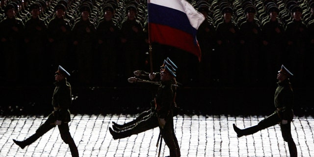 April 30, 2012: Russian servicemen take part in a rehearsal for the annual Victory Day parade in Red Square in Moscow. The DOJ announced arrests in the alleged connection of exported high-tech microelectronics from the U.S. to Russian military and intelligence agencies.