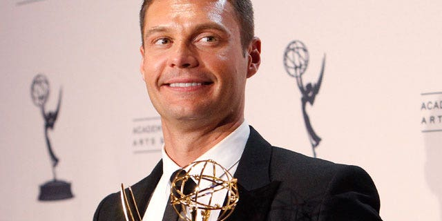 """Aug. 2010: Seacrest holds his Emmy award for Outstanding Reality Program for """"Jamie Oliver's Food Revolution"""" in Los Angeles. (Reuters)"""