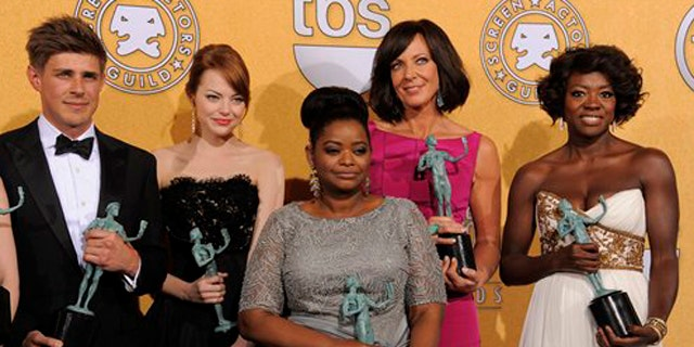 """Jan. 29, 2012: Castmembers of """"The Help"""" pose backstage with their awards for outstanding performance by a cast in a motion picture at the 18th Annual Screen Actors Guild Awards."""