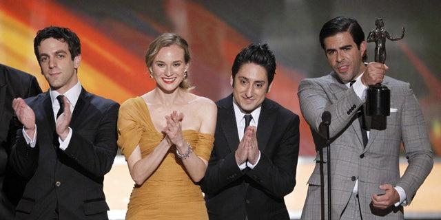 "Jan. 23: B.J. Novak, Diane Kruger, Omar Doom and Eli Roth accept the award for best cast of a movie for ""Inglourious Basterds."" (AP)"