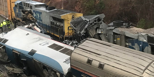 Derailed Amtrak cars after a train traveling from New York to Miami collided with a CSX freight train in South Carolina.