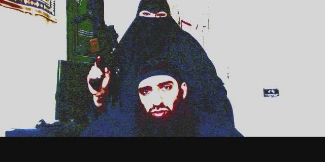 Kathie Smith brandishes a gun in video starring her and her husband, Salahudin Ibn Jafar, that is being investigated by terrorism task force.