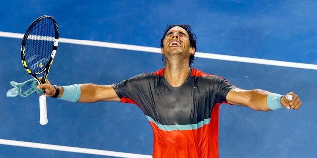 Rafael Nadal celebrates his win over Gael Monfils at the Australian Open in Melbourne, on Jan. 18, 2014.