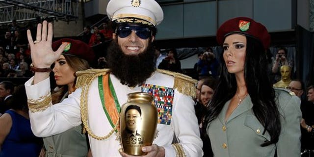Sacha Baron Cohen dressed as his character Aladeen from The Dictator on the red carpet in 2012.