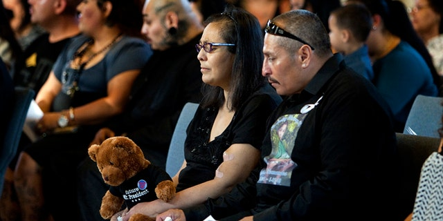 Grandparents Sandra and Robert Fernandez at a memorial service on June 12, 2013 in Sylmar, CA