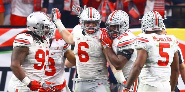 Jan 1, 2016; Glendale, AZ, USA; Ohio State Buckeyes defensive end Sam Hubbard (6) celebrates with teammates after a tackle in the second half against the Notre Dame Fighting Irish during the 2016 Fiesta Bowl at University of Phoenix Stadium. The Buckeyes defeated the Fighting Irish 44-28. Mandatory Credit: Mark J. Rebilas-USA TODAY Sports