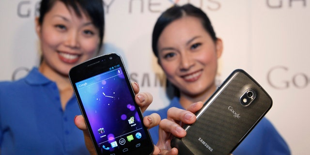 Oct. 19, 2011: Models display the new Galaxy Nexus smartphone -- the first to use the latest version of Google's Android operating system -- during a news conference in Hong Kong.