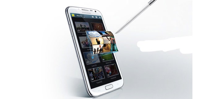 "The Samsung Galaxy Note II -- half smartphone, half tablet, it's been dubbed a ""phablet."" And it's coming soon to a carrier near you."