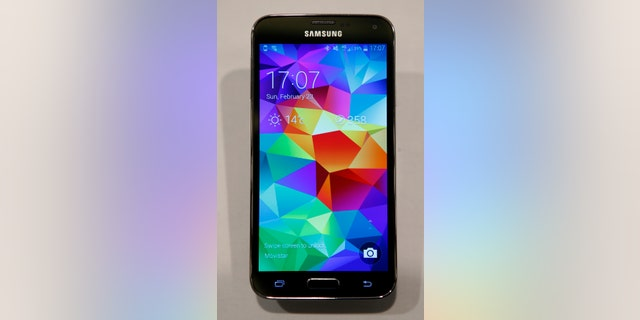 File photo - A new Samsung Galaxy S5 smartphone is seen on a display at the Mobile World Congress in Barcelona Feb. 23, 2014.