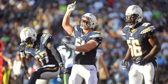 Aug 29, 2015; San Diego, CA, USA; San Diego Chargers linebacker Kyle Emanuel (51) celebrates with defensive back Jahleel Addae (37) and inside linebacker Donald Butler (56) after sacking Seattle Seahawks quarterback Russell Wilson (not pictured) at Qualcomm Stadium. Mandatory Credit: Orlando Ramirez-USA TODAY Sports