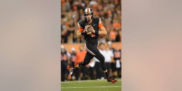Oregon State quarterback Sean Mannion (4) passes against San Diego State during the third quarter of an NCAA college football game in Corvallis, Ore., Saturday, Sept. 20, 2014. (AP Photo/Troy Wayrynen)