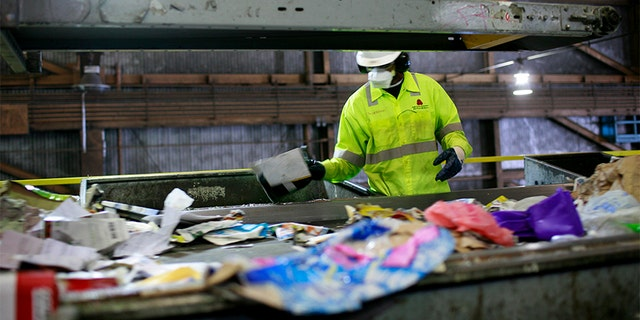 A worker sorts refuse at a San Francisco plant.