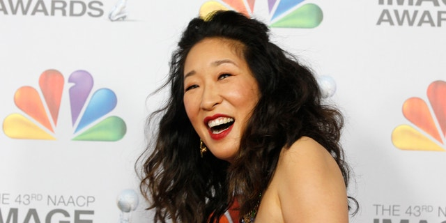 Actress Sandra Oh arrives at the 43rd NAACP Image Awards in Los Angeles, California February 17, 2012.