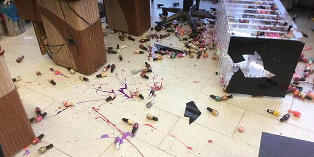 The owner and her staff worked hard after the vandalism to remove the nail polish stains.
