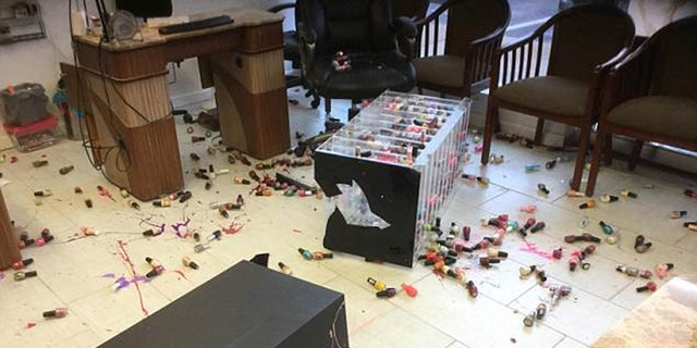 The woman was recorded knocking over a nail polish stand during her rage.