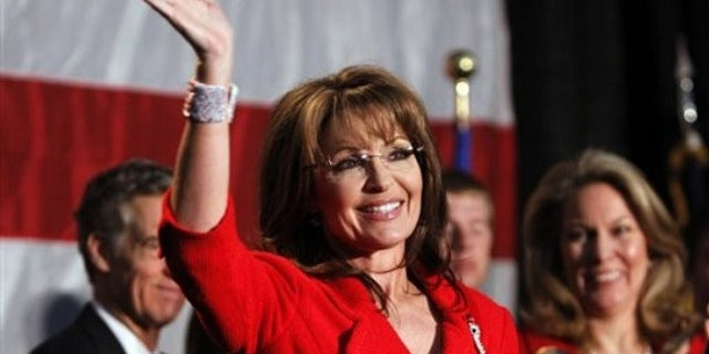 May 2: Former Alaska Governor Sarah Palin waves during a fund raiser at Colorado Christian University in Lakewood, Colo. (AP).