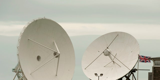 Satellite dishes are seen at GCHQ's outpost at Bude, close to where trans-Atlantic fibre-optic cables come ashore in Cornwall, southwest England June 23, 2013. Britain's spy agency GCHQ has tapped fibre-optic cables that carry international phone and internet traffic and is sharing vast quantities of personal information with the U.S. National Security Agency, the Guardian newspaper said, after publishing details of top-secret surveillance programs exposed by former NSA contractor Edward Snowden.  REUTERS/Kieran Doherty  (BRITAIN - Tags: POLITICS MILITARY BUSINESS TELECOMS) - RTX10Y4F