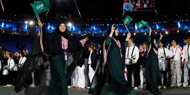 July 27, 2012: Saudi Arabia's athletes parade, Wojdan Ali Seraj Abdulrahim Shaherkani , center, during the Opening Ceremony at the 2012 Summer Olympics, in London.