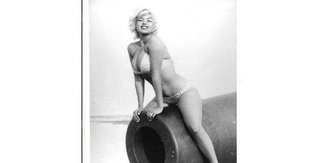 Jayne Mansfield at Ship Island straddling a cannon. The photo was taken on the yacht of Elaine's father, named The Blue Dolphin.