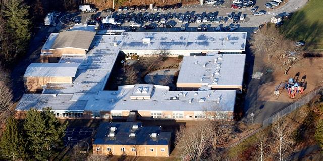 This Dec. 14, 2012 aerial file photo shows Sandy Hook Elementary School in Newtown, Conn. Newtown, Conn.