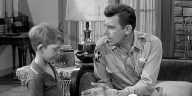 Ron Howard (left) opposite Andy Griffith.