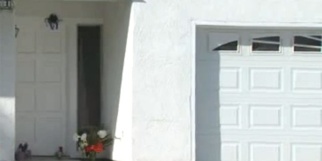Mar. 24, 2012: Flowers lay in front of a home where a San Diego-area mother was beaten Wednesday morning.