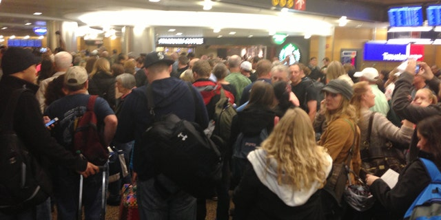 Mar. 19, 2013: Passengers wait at Seattle-Tacoma International Airport after a security breach.