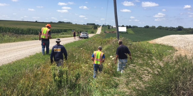 Search crews check ditches near the pig farm that was searched by FBI investigators last week.