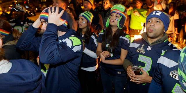 Feb. 1, 2015: Stunned Seattle Seahawks fans watching Super Bowl XLIX  on outdoor TV screens react during the final minutes of the fourth quarter as the New England Patriots beat the Seahawks, 28-24. AP Photo/Ted S. Warren)