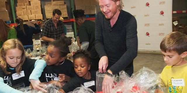 Nov.13, 2012: Phillip Sweet, center, and Nashville area children stuff backpacks in support of the Second Harvest Food Bank of Middle Tennessee Backpack program.