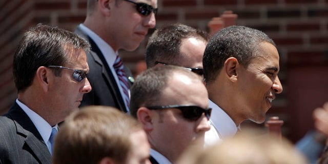 FILE - In this Monday, June 30, 2008 file photo, Secret Service agents surround Democratic presidential candidate Sen. Barack Obama as he greets supporters in Independence, Mo. The Secret Service has been tarnished by a prostitution scandal that erupted April 13, 2012 in Colombia involving 12 Secret Service agents, officers and supervisors and 12 more enlisted military personnel ahead of President Barack Obama's visit there for the Summit of the Americas. (AP Photo/Jae C. Hong)