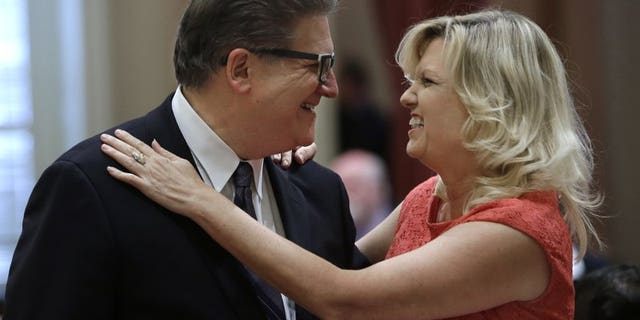 Hertzberg and state Sen. Cathleen Galgiani, D-Stockton, greet each other after their summer recess, at the Capitol in Sacramento, Calif., Aug. 17, 2015.