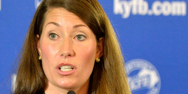 In this Aug. 20, 2014 file photo, Kentucky Democratic Senate candidate Alison Lundergan Grimes speaks in Louisville, Ky.