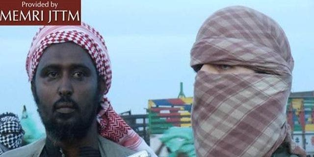Oct. 14, 2011: Al-Shabaab spokesman Ali Mahmoud Rage, left, and Al Qaeda spokesman Abu Abdallah Al-Muhajir speak to reporters.