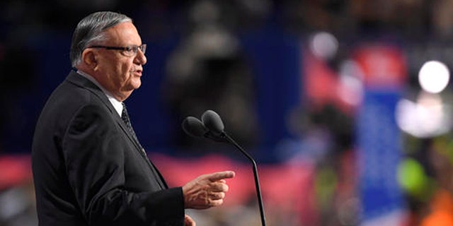 FILE - In this Thursday, July 21, 2016, file photo, Maricopa County, Ariz., Sheriff Joe Arpaio speaks during the final day of the Republican National Convention in Cleveland. Attorneys for Arpaio and his second-in-command are expected to urge a federal judge at a hearing Friday against recommending that prosecutors file a criminal contempt-of-court case against the pair for ignoring court orders in a racial profiling case. (AP Photo/Mark J. Terrill, File)