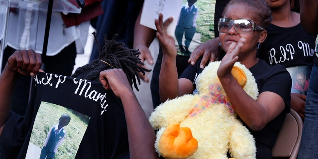 May 3, 2014: Sharain Spruill, mother of Martin Cobb, is surrounded by family during his prayer vigil.  A 16-year-old boy was charged Saturday in the assault of a young girl and the killing of her 8-year-old brother, Martin, who was apparently slain when he tried to protect her, authorities and relatives said. (AP Photo/Richmond Times-Dispatch, Dean Hoffmeyer)