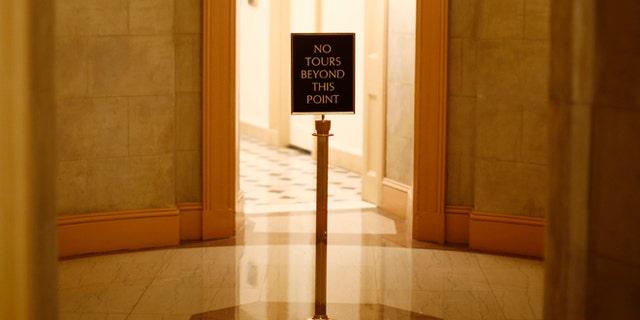 FILE: A view of a sign stand at the U.S. Capitol. By going to court, the SEC has signaled that it disagrees with the reasons given by Congress for refusing to turn over evidence in the case.