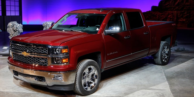 General Motors displays its 2014 Chevrolet Silverado full-size pickup truck after unveiling it and the 2014 GMC Sierra full-size pickup in Pontiac, Michigan.