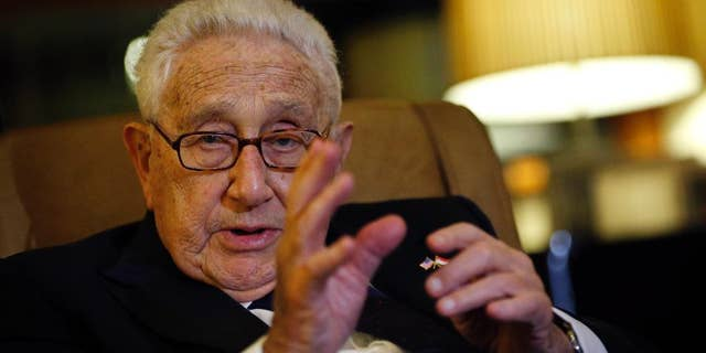 Former U.S. Secretary of State Henry Kissinger speaks to reporters Saturday, March 28, 2015, in Singapore. (Associated Press)